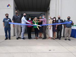 Ability First and FVO Solutions merged with a ribbon cutting